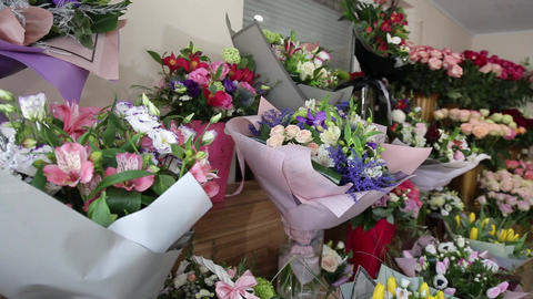 Many beautiful fresh floral bouquets on exposition in flower shop Live Action