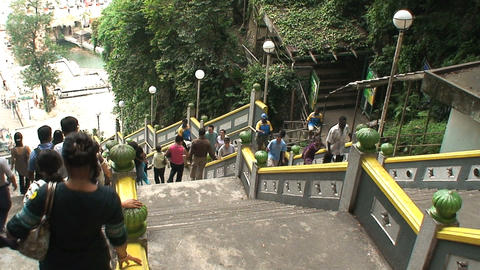 People walking out and in from the Batu Caves Stock Video Footage