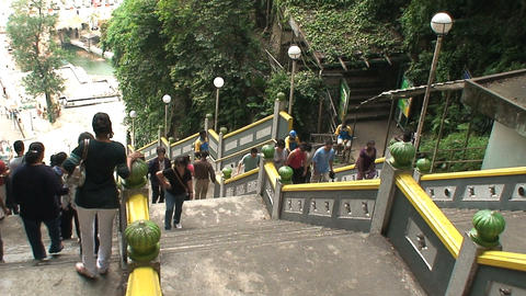 People walking out and in from the Batu Caves Footage