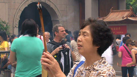 Woman praying at the Jing'an Temple Footage