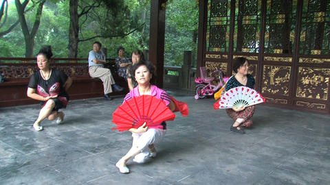 Chinese people dancing with chinese fan Stock Video Footage