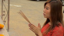 Thai Woman Praying with Incense at a Temple Footage