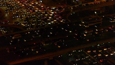 nighttime traffic pollution in city,cars jam troop slow moving on busy overpass Footage