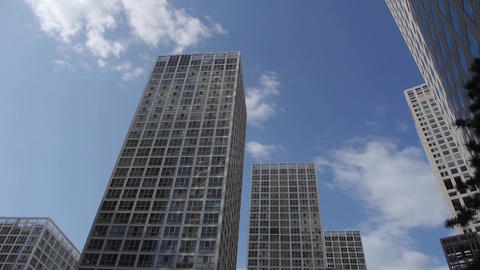 timelapse clouds over corporate buildings Stock Video Footage