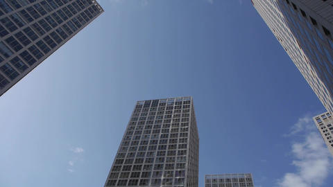 Rotate camera lens of corporate buildings Stock Video Footage