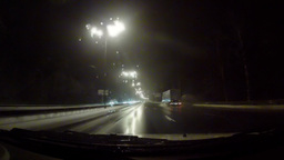 Car moving on the night road through snowstorm Stock Video Footage