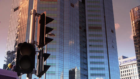 sunset skyscraper,CBD tall office buildings,traffic light Stock Video Footage