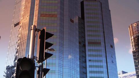 sunset skyscraper,CBD tall office buildings,traffic light Footage