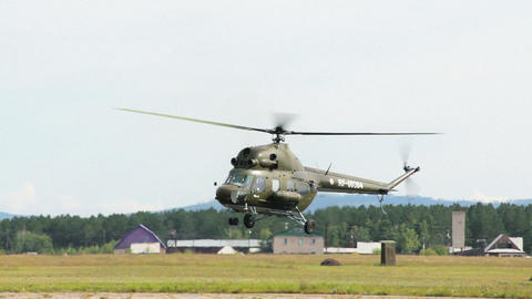 Russian military helicopter Mi-2 at airshow Stock Video Footage