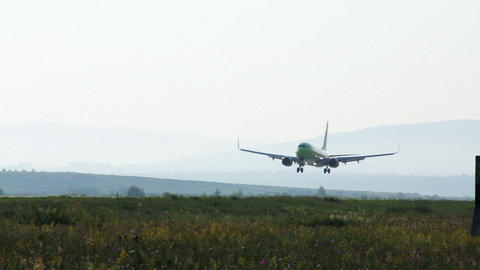Plane landing at airport edited Stock Video Footage