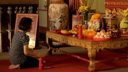 Woman Praying at a Shrine to Kwan Yin (Kuan Im) Stock Video Footage