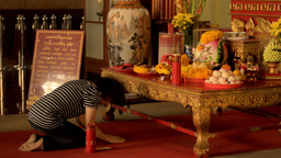Woman Praying at a Shrine to Kwan Yin (Kuan Im) Stock Video Footage