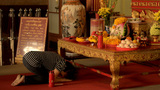 Woman Praying at a Shrine to Kwan Yin (Kuan Im) Footage