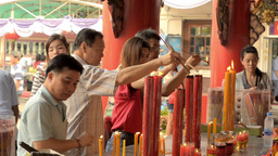 Thai People Lighting Candles at a Temple Footage