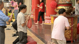Thai Men Praying on the Eve of Chinese New Year Stock Video Footage