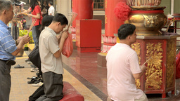 Thai Men Praying On The Eve Of Chinese New Year stock footage