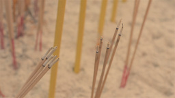 Burning Incense Sticks at a Temple Stock Video Footage