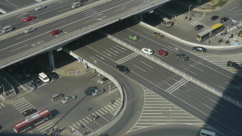 Aerial view of crosswalk & overpass traffic at an urban city Footage