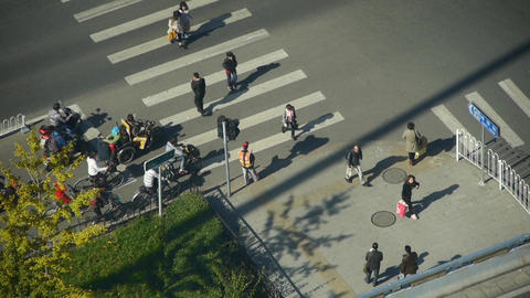 Aerial view of crosswalk & traffic at an urban... Stock Video Footage