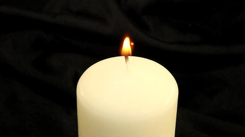 Lighting a candle with a match Stock Video Footage