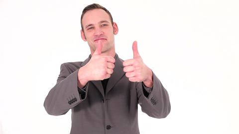 Young businessman holds up the thumb gesture Stock Video Footage