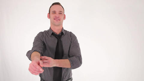Young businessman rolls up a sleeve Stock Video Footage