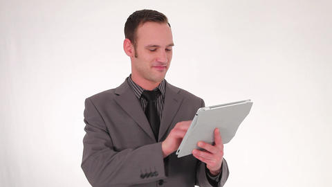 Businessman working on a tablet Footage