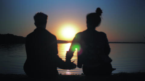 Silhouette couple in love on sunset. Love and romantic, st. Valentine's Day Live Action