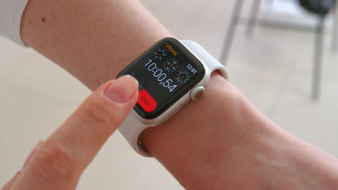 Smartwatch. Young woman using smart watch. Closeup of female touching touch Live Action