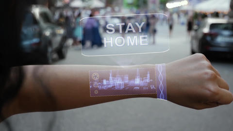 Female hand activates hologram Stay Home Live Action
