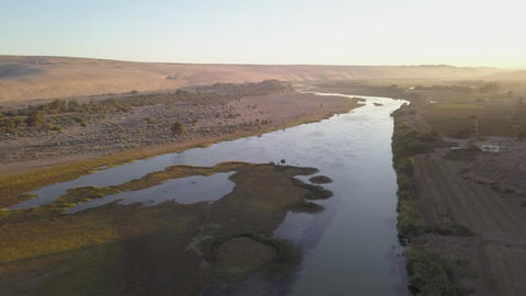 Aerial of a river flowing through the desert Live Action