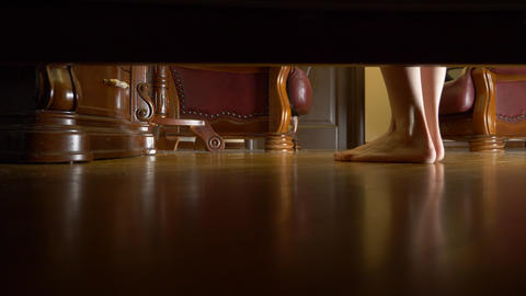 4k, view from under the bed. female feet. a woman cleanses her feet and goes to Live Action