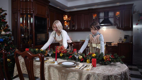 Wide shot portrait of cheerful Caucasian mother and son putting Christmas Live Action