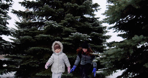 Cheerful smiling children play snowballs on the street, run and throw Live Action