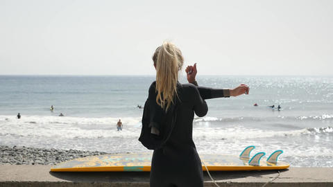 A Girl Does a Warm up Before Surfing Live Action