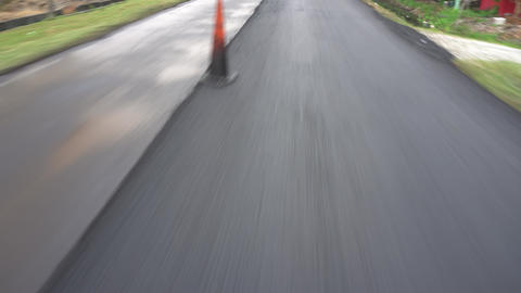 Finish surface road construction tar road Live Action