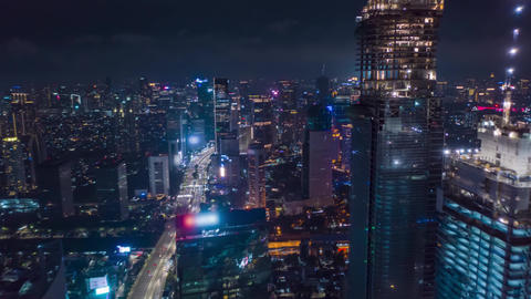 Hyper Lapse Motion Time Lapse at Night above of modern city center with Live Action