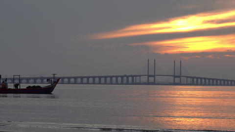 After fisherman collect net, they continue journey near Penang Bridge Live Action