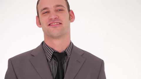 Successful businessman straightening his tie Stock Video Footage