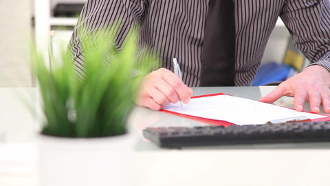 Businessman writing notes, close up hands Stock Video Footage