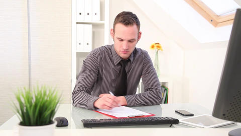 Businessman writing notes at his desk Footage