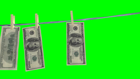 drying of the dollar banknotes.Isolated over green alpha Stock Video Footage