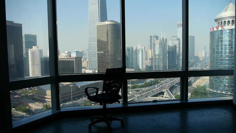 an empty chair rotating against business building from french window Animation