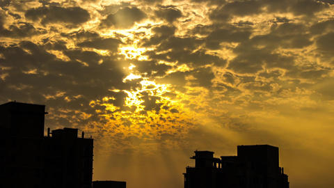 Cloudy Sunset with Light Rays Stock Video Footage