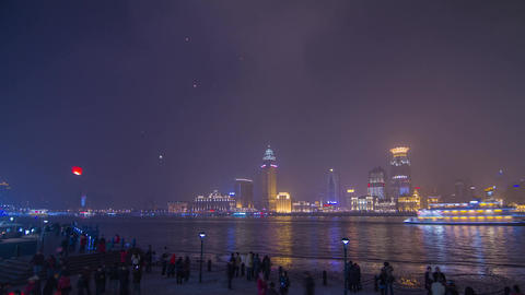 Crowds and Boats Traffic by The Bund with flying l Stock Video Footage
