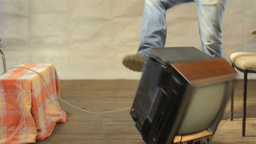 Angry Man Throwing Broken TV to the Ground Stock Video Footage