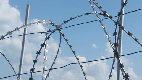 Sky Behind Barbed Wire 2 Stock Video Footage