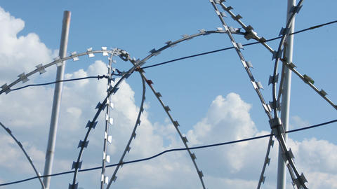 Sky Behind Barbed Wire 2 stock footage