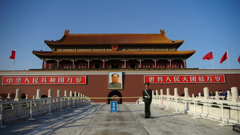 China Police on Beijing Tiananmen,MaoZeDong portrait & slogans Footage
