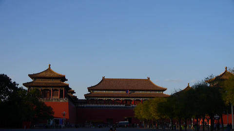 Man people walking before the Forbidden City palace in dusk Stock Video Footage